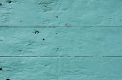träcyan målade plankor Arkivfoto