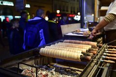 Trdelník - the cake. The cake Trdelník is the traditional central-european cake and sweet pastry. It is made from rolled dough that is wrapped around a stick Royalty Free Stock Photo