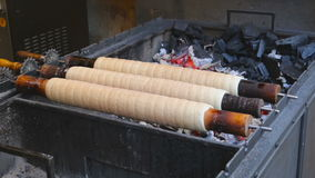 Trdelnik bakery on the street market in Prague. Czech Republic. Czech sweetness stock footage