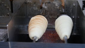 Trdelnik baking on the street of Prague. Traditional Trdelnik baking on the street of Prague stock footage