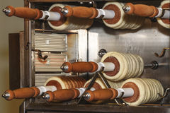 Trdelnik is traditional Slovak cake and sweet pastry. Baking of. Trdelnik is a traditional Slovak cake, sweet pastry. Baking of Trdelnik. Bugler is bread dough Stock Image