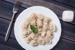Trditional russian meat dumplings on the wooden table, top view still life Royalty Free Stock Photos