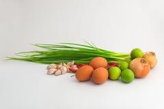 Tre ägg och ingredienser för asiatisk mat i grå bakgrund royaltyfria foton
