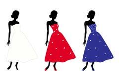 Tre älskvärda damtoalett i olik klänning Royaltyfria Bilder