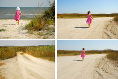 Tre år gammalt gå in mot stranden arkivfoto