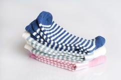 Tre accoppiamenti dei calzini a strisce immagini stock libere da diritti