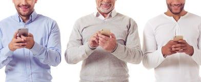 Tre affärsmän med grejer arkivfoton