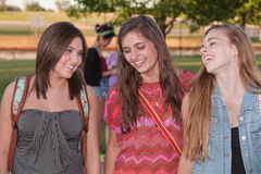 Tre allievi femminili felici Fotografia Stock Libera da Diritti