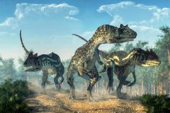 Tre Allosauruses royaltyfria bilder