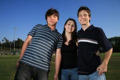 Tre amici all'aperto Immagini Stock