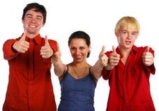 Tre amici dà il gesto Immagine Stock