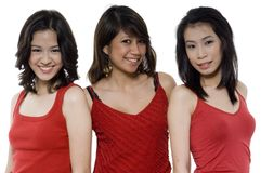 Tre amici nel colore rosso Immagini Stock