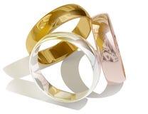 Tre anelli dorati differenti Fotografia Stock
