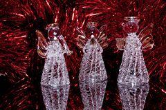 Tre angeli di vetro decorativi sopra Fotografia Stock Libera da Diritti