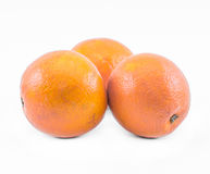 Tre apelsiner på en vit bakgrund - främre sikt Arkivfoto