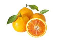 Tre arance con half2 Immagine Stock Libera da Diritti