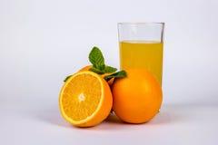 Tre arance con succo Fotografia Stock
