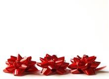Tre archi del regalo di colore rosso Fotografie Stock