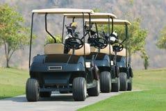 Tre automobili di golf immagine stock libera da diritti