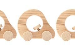 Tre automobili di legno del giocattolo Fotografia Stock