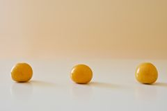 Tre bacche dorate Fotografia Stock