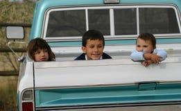 Tre bambini in camion Fotografie Stock Libere da Diritti