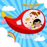 Tre bambini che pilotano un aeroplano attraverso il cielo Fotografie Stock
