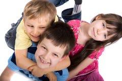 Tre bambini felici Immagini Stock Libere da Diritti