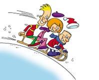 Tre bambini felici che sledging Immagini Stock