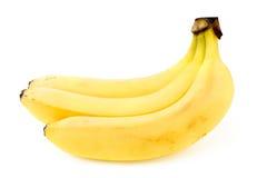 Tre banane su un bianco Fotografia Stock