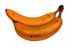 Tre bananer i gruppen som isoleras (avskilt) på vit Arkivfoto