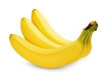 Tre bananer som isoleras på vit Royaltyfria Bilder