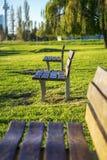 Tre banchi di parco Fotografie Stock