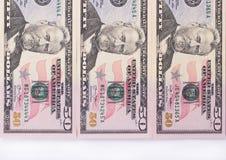 Tre banconote di 50 dollari isolate su fondo bianco Immagine Stock Libera da Diritti