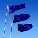 Tre bandierine dell'unione dell'Europa contro cielo blu. Fotografia Stock Libera da Diritti