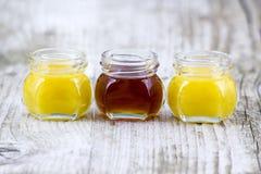 Tre barattoli di miele Fotografia Stock