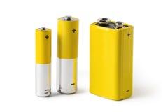 Tre batterier som isoleras på vit bakgrund Royaltyfri Fotografi
