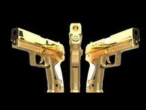 Tre belle pistole dorate brillanti parallelamente fotografia stock