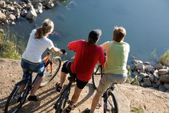 Tre bicyclists Fotografia Stock