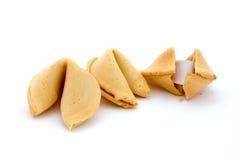 Tre biscotti di fortuna sopra bianco Fotografia Stock