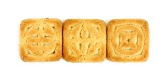 Tre biscotti quadrati Fotografie Stock Libere da Diritti