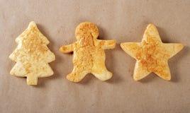 Tre biscotti su pergamena Immagine Stock