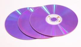 Tre blåa dubbellager DVDs Arkivbild