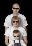 Tre blonda män i solglasögon Arkivbild