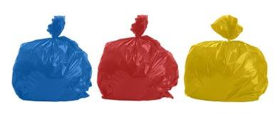 Tre borse colorate dei rifiuti Fotografia Stock Libera da Diritti