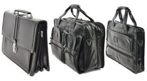 Tre borse di cuoio nere isolate su fondo bianco Riassunto stabilito Immagine Stock Libera da Diritti