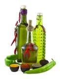 Tre bottiglie con peperone verde Fotografia Stock Libera da Diritti