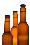 Tre bottiglie da birra (percorso di residuo della potatura meccanica incluso) Fotografie Stock