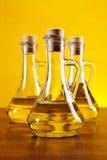 Tre bottiglie dell'olio di oliva Immagine Stock