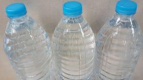 Tre bottiglie di acqua Fotografia Stock